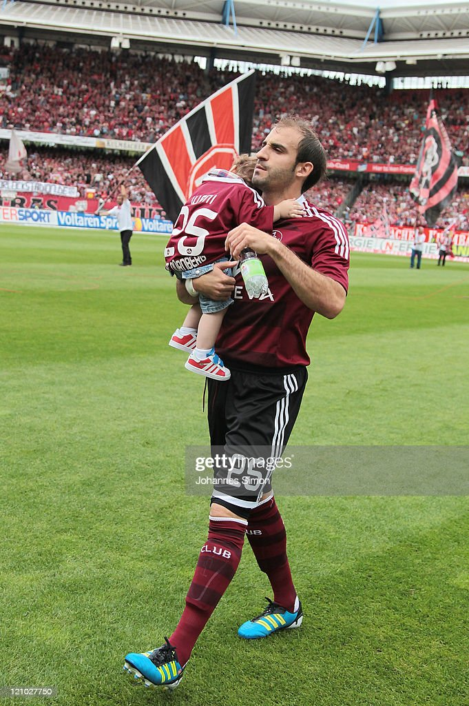 Javier Pinola of Nuernberg carries his little ahead of the Bundesliga match between 1 FC Nuernberg and Hannover 96 at Easy Credit Stadium on August...