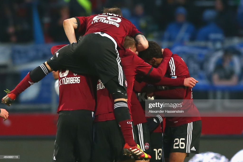 Javier Pinola of Nuernberg celebrates the 4th team goal with his team mates during the Bundesliga match between 1 FC Nuernberg and TSG 1899...