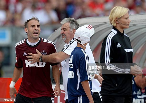 Javier Pinola of Nuernberg complains against the 4th referee Bibiana Steinhaus beeing booked the yellowred card during the Bundesliga match between 1...