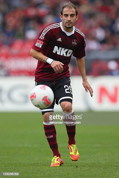 Javier Pinola of Nuernberg holds the ball during the Bundesliga match between 1 FC Nuernberg and VfB Stuttgart at Easy Credit Stadium on September 29...