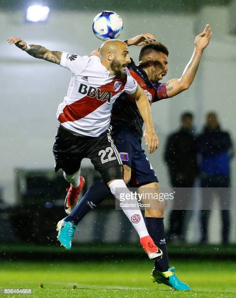 Javier Pinola of River Plate fights for the ball with Denis Stracqualursi of Tigre during a match between Tigre and River Plate as part of Superliga...