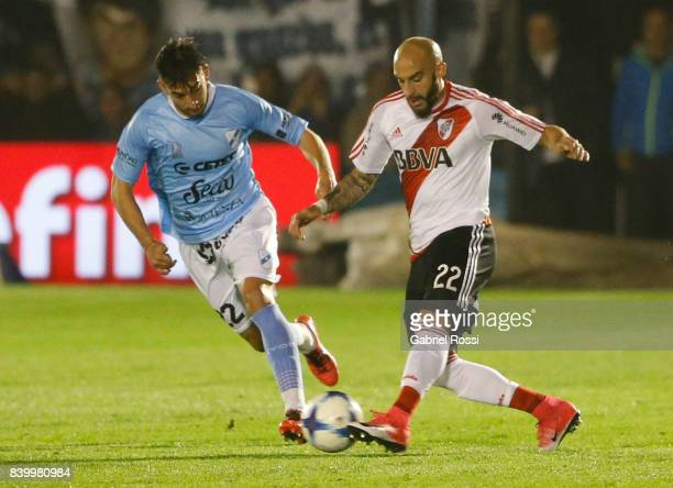 Javier Pinola of River Plate fights for the ball with Juan Sanchez Sotelo of Temperley during a match between Temperley and River Plate as part of...