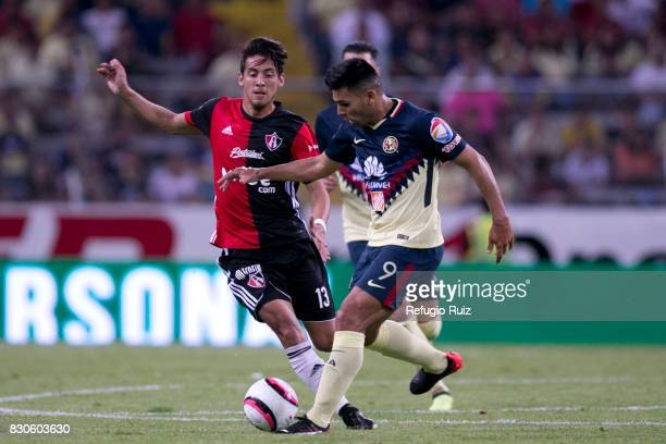 Javier Salas of Atlas fights for the ball with Silvio Romero of America during the 4th round match between Atlas and America as part of the Torneo...