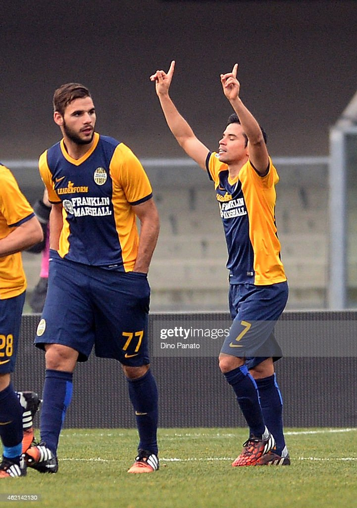 <a gi-track='captionPersonalityLinkClicked' href=/galleries/search?phrase=Javier+Saviola&family=editorial&specificpeople=207198 ng-click='$event.stopPropagation()'>Javier Saviola</a> (R) of Hellas Verona celebrates after scoring the opening goal during the Serie A match between Hellas Verona FC and Atalanta BC at Stadio Marc'Antonio Bentegodi on January 25, 2015 in Verona, Italy.