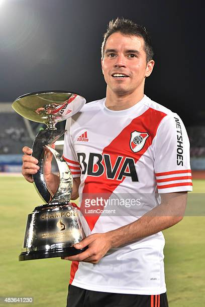 Javier Saviola of River Plate poses with the trophy after winning a match between Gamba Osaka and River Plate at Osaka Expo '70 Stadium on August 11...