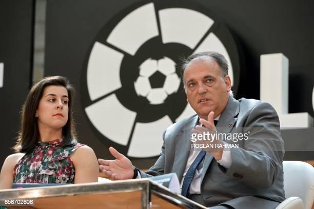 Javier Tebas president of La Liga speaks while Carolina Marin Laliga ambassador listen during the official launch of Spanish Football League La Liga...