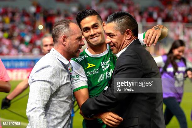 Javier Torrente coach of Leon greets Andres Andrade of Queretaro and Marcos Ambriz coach of Necaxa during the 4th round match between Necaxa and Leon...