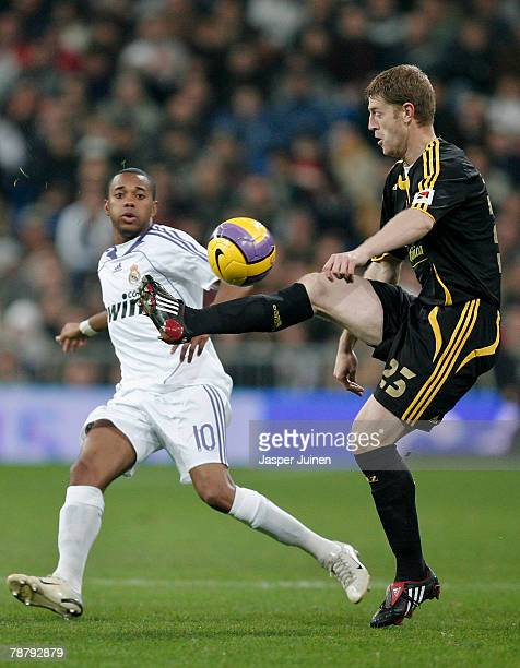Javier Vallejo of Zaragoza controls the ball flanked by Robinho of Real Madrid during the La Liga match between Real Madrid and Zaragoza at the...
