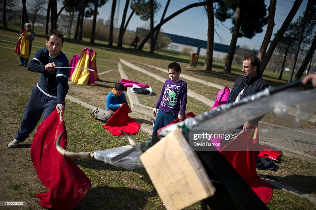 Javier Vila (L), 39, practices bullfighting in a city park in Santa Perpetua de la Mogoda on March 3, 2013 in Barcelona, Spain. On February 12 the Spanish Parliament accepted a petition from bullfight supporters asking for the sport to become a key part of the Spain's cultural heritage. The petition, of 590,000 signatures, has been promoted by the Federation of Bullfighting Entities of Catalonia. The last bullfight in Catalonia was held in September 25, 2011.