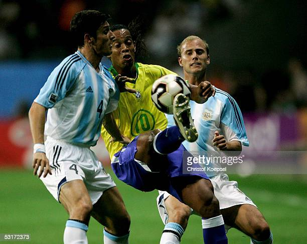 Javier Zanetti and Esteban Cambiasso of Argentina tackle Ronaldinho of Brazil during the FIFA 2005 Confederations Cup Final between Brazil and...