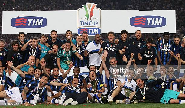 Javier Zanetti and Marco Materazzi with their FC Internazionale Milano teammates hold the trophy after the victory of Tim Cup final between FC...
