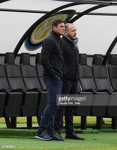 Javier Zanetti and Piero Ausilio look on during the FC Internazionale training session at the club's training ground at Appiano Gentile on October 15...