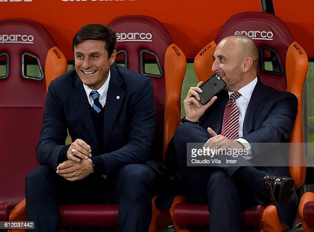 Javier Zanetti and Piero Ausilio of FC Internazionale chat prior to the Serie A match between AS Roma and FC Internazionale at Stadio Olimpico on...
