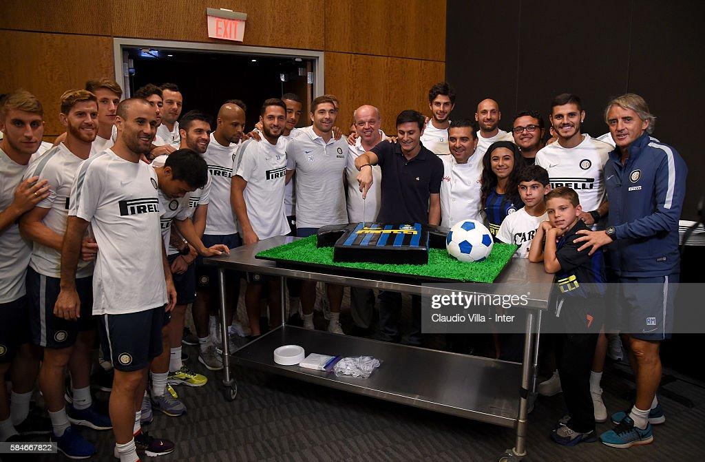 Javier Zanetti Buddy Valestro Mauro Castano Roberto Mancini and player of FC Internazionale pose for a photo after the FC Internazionale training...