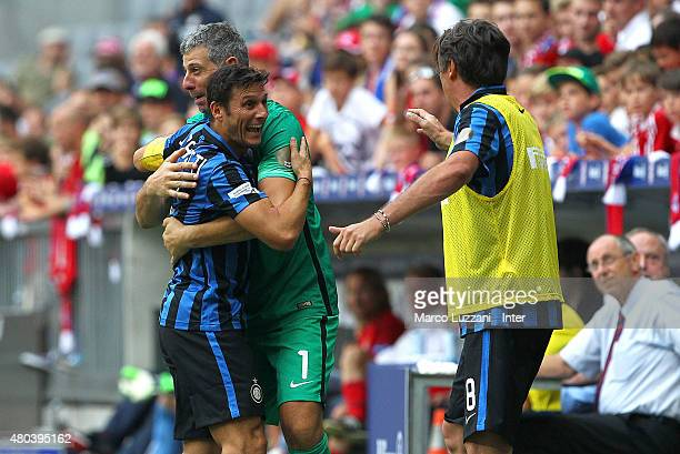 Javier Zanetti Francesco Toldo and Nicola Berti of Inter Forever celebrates his teammates goal during the friendly match between FCB AllStars and...
