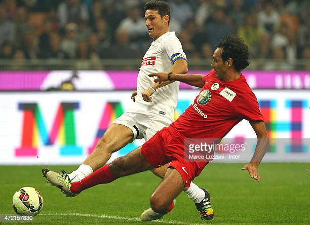 Javier Zanetti is challenged by Alessandro Nesta during the Zanetti and friends Match for Expo 2015 at Stadio Giuseppe Meazza on May 4 2015 in Milan...