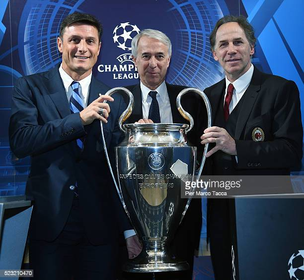 Javier Zanetti Mayor of Milan Giuliano Pisapia and Franco Baresi pose during the press conference to present the UEFA Champions League Trophy display...