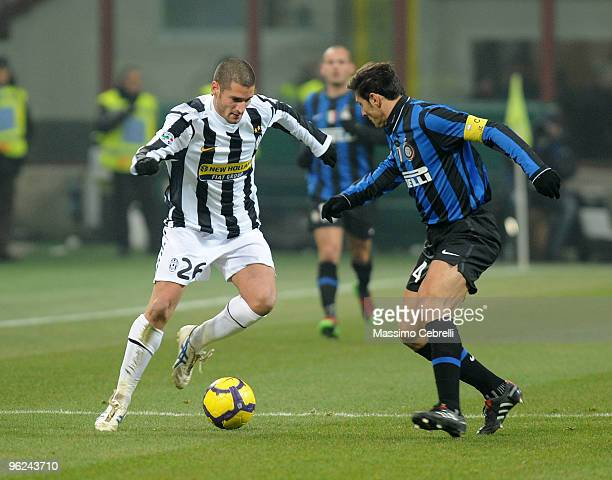 Javier Zanetti of FC Inter Milan battles for the ball against Antonio Candreva of Juventus FC during the Tim Cup match between FC Inter Milan and...