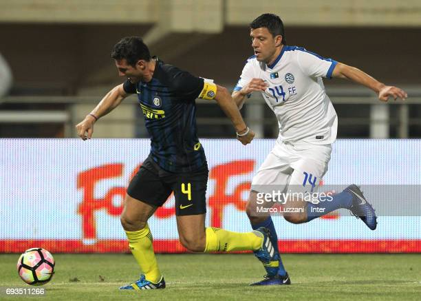 Javier Zanetti of Inter Forever competes for the ball with Panagiotis Fyssas of Greece 2004 during the friendlt match between Greece 2004 and Inter...