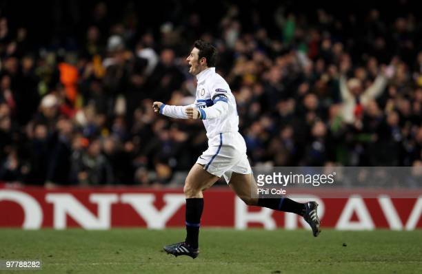 Javier Zanetti of Inter Milan celebrates the goal scored by Samuel Eto'o of Inter Milan during the UEFA Champions League Round of 16 second leg match...