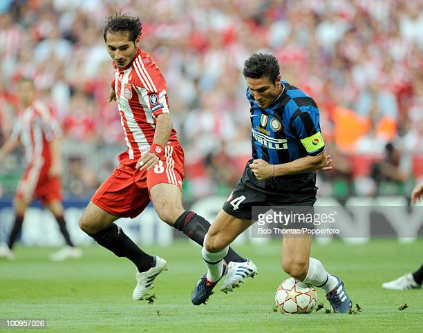 Javier Zanetti of Inter Milan clashes with Hamit Altintop of Bayern Munich during the UEFA Champions League Final match between Bayern Munich and...