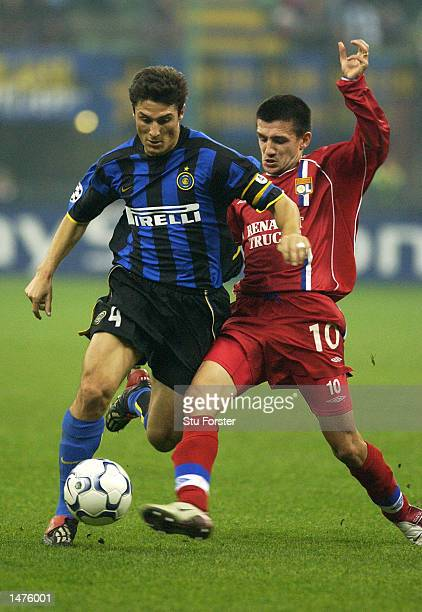 Javier Zanetti of Inter Milan goes past Eric Carriere of Lyon during the UEFA Champions League First Phase Group C match between Inter Milan and Lyon...