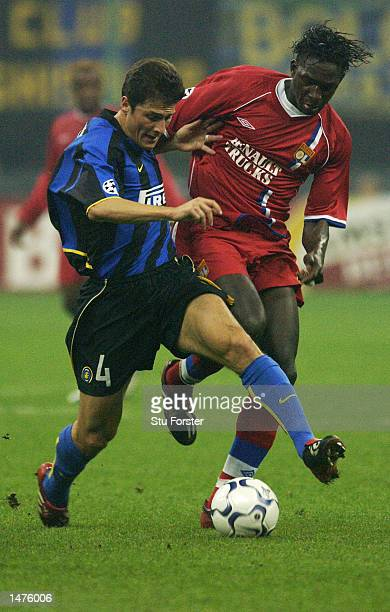 Javier Zanetti of Inter Milan is chased by Mahamadou Diarra of Lyon during the UEFA Champions League First Phase Group C match between Inter Milan...