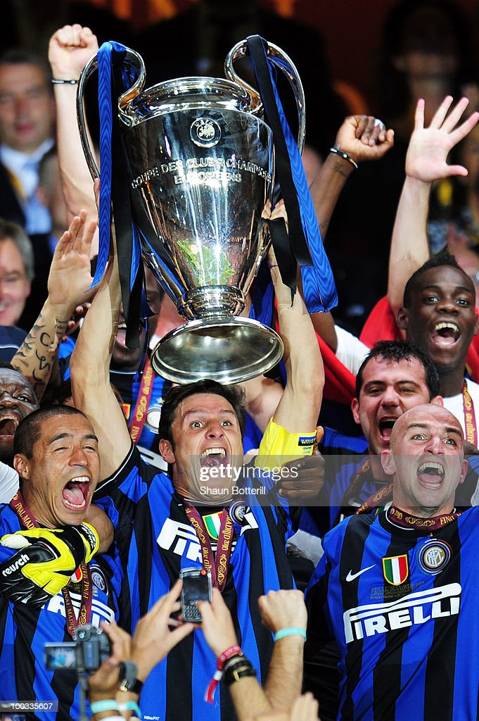 Javier Zanetti of Inter Milan lifts the UEFA Champions League trophy following their team's victory at the end of the UEFA Champions League Final match between FC Bayern Muenchen and Inter Milan at the Estadio Santiago Bernabeu on May 22, 2010 in Madrid, Spain.