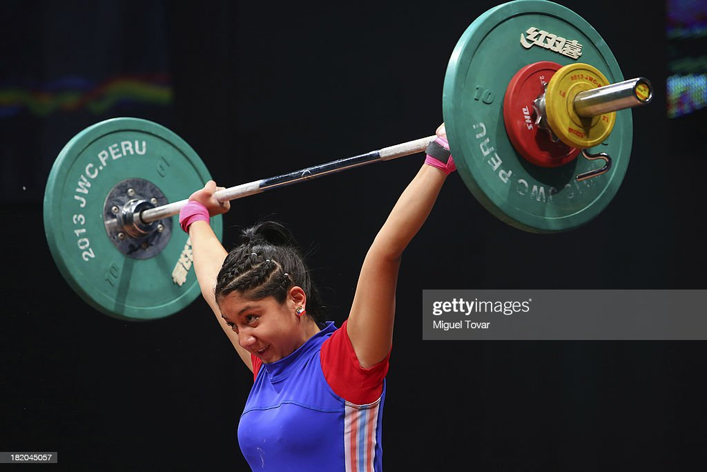 Javiera Pereira of Chile competes in women's 53 kg as part of the I ODESUR South American Youth Games at Coliseo Miguel Grau on September 27, 2013 in Lima, Peru.