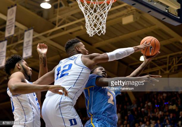 Javin DeLaurier of the Duke Blue Devils blocks a shot by Emanual Shepherd of the Southern University Jaguars during their game at Cameron Indoor...