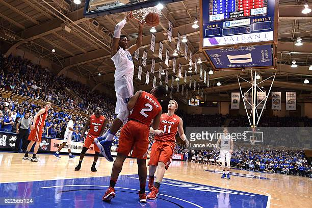 Javin DeLaurier of the Duke Blue Devils dunks the ball against Brian Parker and Tobias Sjoberg of the Marist Red Foxes at Cameron Indoor Stadium on...