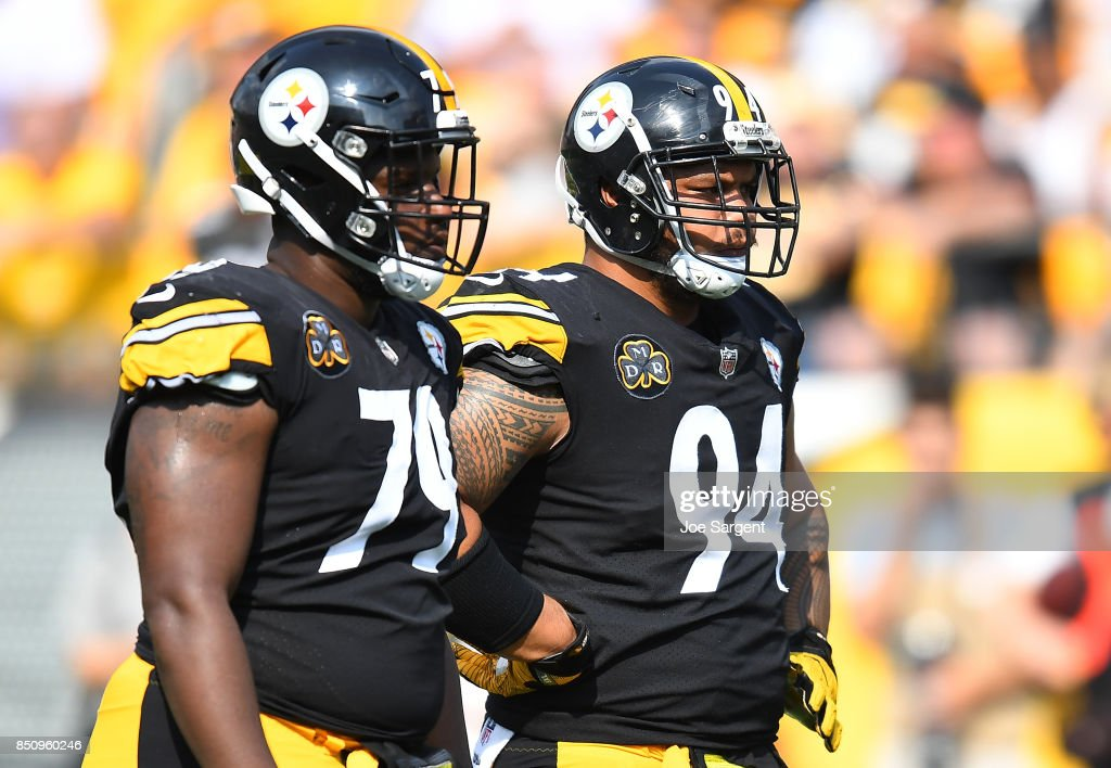 df21b8ca8 ... Javon Hargrave 79 and Tyson Alualu 94 of the Pittsburgh Steelers look  on during ...