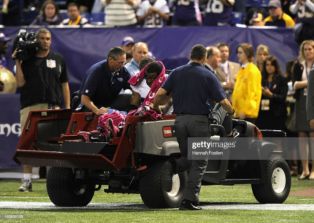 <a gi-track='captionPersonalityLinkClicked' href=/galleries/search?phrase=Javon+Ringer&family=editorial&specificpeople=2168462 ng-click='$event.stopPropagation()'>Javon Ringer</a> #21 of the Tennessee Titans carted off the field after being injured during the fourth quarter of the game against the Minnesota Vikings on October 7, 2012 at Mall of America Field at the Hubert H. Humphrey Metrodome in Minneapolis, Minnesota. The Vikings defeated the Titans 30-7.