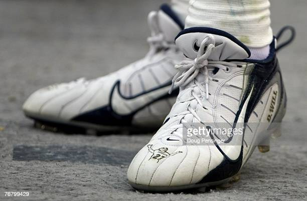 Javon Walker of the Denver Broncos has custom shoes with icons in tribute of Darrent Williams who was killed as the Denver Broncos defeated the...