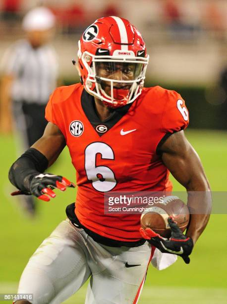 Javon Wims of the Georgia Bulldogs runs with a catch against the Missouri Tigers at Sanford Stadium on October 14 2017 in Athens Georgia