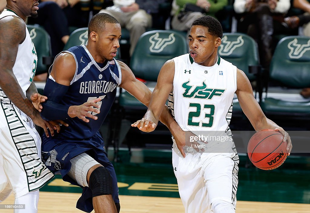 JaVontae Hawkins #23 of the South Florida Bulls drives as Jabril Trawick #55 of the Georgetown Hoyas defends during the game at the Sun Dome on January 19, 2013 in Tampa, Florida.