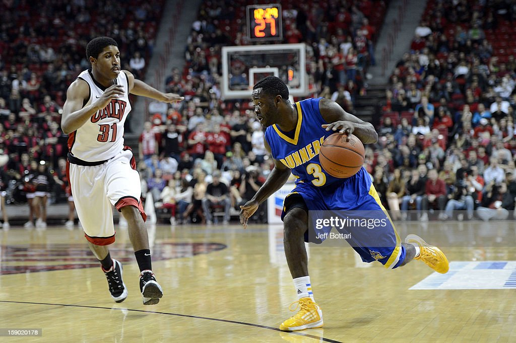 Javonte Maynor #3 of the CSU Bakersfield Roadrunners drives to the hoop against <a gi-track='captionPersonalityLinkClicked' href=/galleries/search?phrase=Justin+Hawkins&family=editorial&specificpeople=171558 ng-click='$event.stopPropagation()'>Justin Hawkins</a> #31 of the UNLV Rebels at the Thomas & Mack Center on January 5, 2013 in Las Vegas, Nevada.