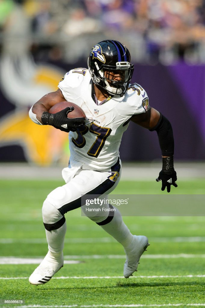 Javorius Allen #37 of the Baltimore Ravens carries the ball against the Minnesota Vikings during the game on October 22, 2017 at US Bank Stadium in Minneapolis, Minnesota.