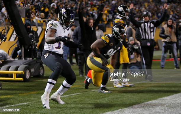 Javorius Allen of the Baltimore Ravens celebrates after rushing for a 9 yard touchdown in the fourth quarter during the game against the Pittsburgh...