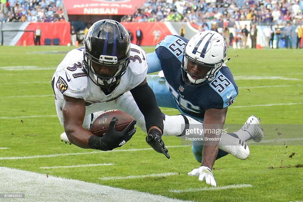 Javorius Allen #37 of the Baltimore Ravens dives towards the endzone pylon but comes up short as he is tackled by Jayon Brown #55 of the Tennessee Titans during the second half at Nissan Stadium on November 5, 2017 in Nashville, Tennessee.