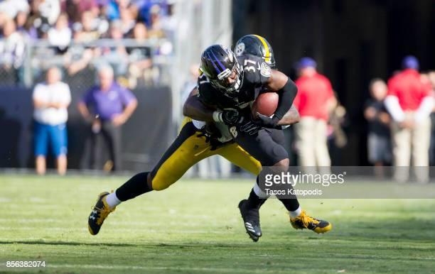 Javorius Allen of the Baltimore Ravens is tackled by Bud Dupree of the Pittsburgh Steelers in the four quarter at MT Bank Stadium on October 1 2017...