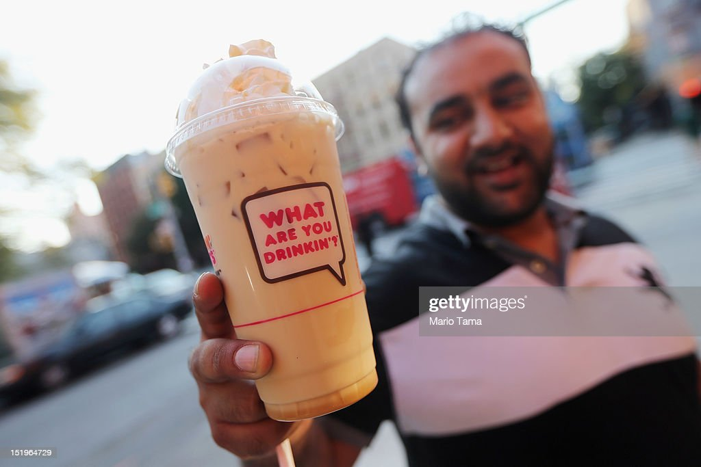 Jawad Rasur displays a 24-ounce iced latte he purchased at Dunkin Donuts in Manhattan after the New York City Board of Health voted to ban the sale of large sugary drinks at restaurants and concessions on September 13, 2012 in New York City. Rasur said, 'It's stupid, it's taking away people's freedom. I'm adult enough.' The controversial measure bars the sale of sugar drinks larger than 16 ounces in an effort to combat obesity.