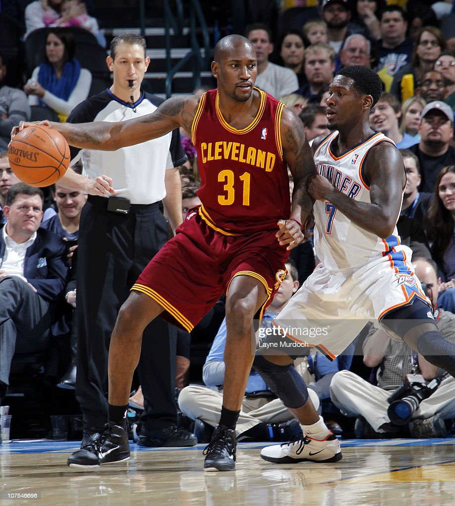 <a gi-track='captionPersonalityLinkClicked' href=/galleries/search?phrase=Jawad+Williams&family=editorial&specificpeople=200696 ng-click='$event.stopPropagation()'>Jawad Williams</a> #31 of the Cleveland Cavaliers drives by <a gi-track='captionPersonalityLinkClicked' href=/galleries/search?phrase=Royal+Ivey&family=editorial&specificpeople=209331 ng-click='$event.stopPropagation()'>Royal Ivey</a> #7 of the Oklahoma City Thunder on December 12, 2010 at the Ford Center in Oklahoma City, Oklahoma.