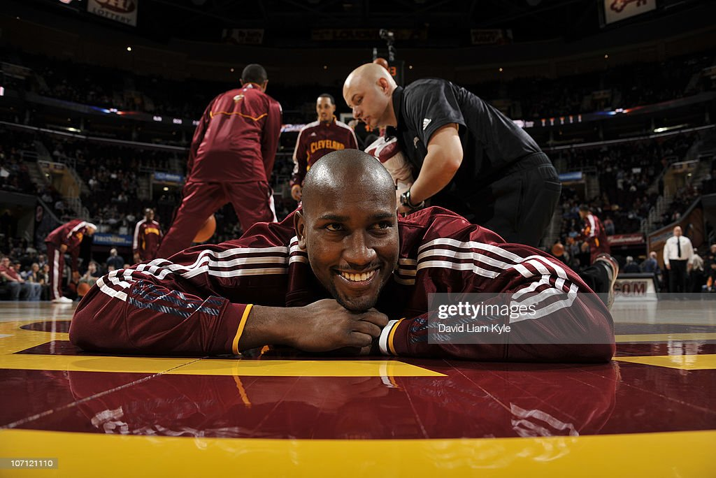 <a gi-track='captionPersonalityLinkClicked' href=/galleries/search?phrase=Jawad+Williams&family=editorial&specificpeople=200696 ng-click='$event.stopPropagation()'>Jawad Williams</a> #31 of the Cleveland Cavaliers smiles as he is stretched out prior to the game against the Milwaukee Bucks at The Quicken Loans Arena on November 24, 2010 in Cleveland, Ohio.