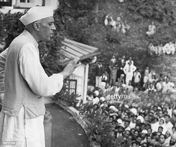 Jawaharlal Nehru addresses a crowd from the balcony of his house in Simla India