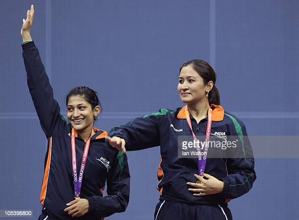 Jawala Gutta and Ashwini Machimanda of India celebrate after winning a gold medal against Shinta Mulia Sari and Lei Yao of China in the women's...