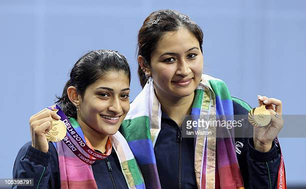 Jawala Gutta and Ashwini Machimanda of India celebrates after winning a gold medal against Shinta Mulia Sari and Lei Yao of China in the women's...