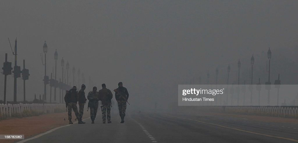 Jawans during Rehearsal for Republic day in the foggy morning at Rajpath on December 28, 2012 in New Delhi, India. While the maximum temperature was recorded at 19 deg C, up from yesterday's temperature by 2.4 degrees, the minimum temperature today dipped to 6.3 deg C, a degree below the normal.