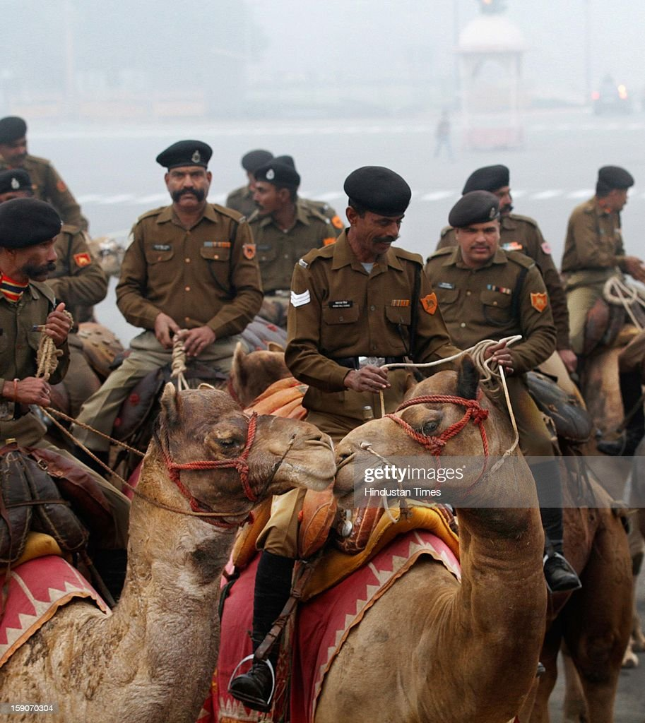 Jawans of BSF Camel corps on their camels rehearse for the Republic Day parade on a cold and foggy morning at Raisina Hill on January 7, 2013 in New Delhi, India. Dense fog and icy winds disrupted normal life as Delhi's minimum temperature settled at five notches below average at 2.4 degrees Celsius. Fog forced visibility to drop to about 500 metres in the morning resulting in 15 flights and 42 trains were delayed out of Delhi while 18 trains got cancelled.