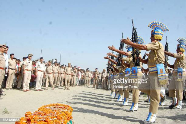 Jawans paying tribute to Sukma Martyr CRPF ASI Naresh Kumar during the funeral at his native village Jainpur Tikola on April 26 2017 in Sonepat India...